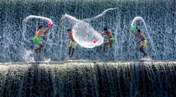 Boys water fight, Tukad Unda dam, Bali, Indonesia, Southeast Asia, Asia